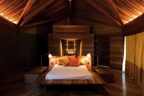 Спальня в дизайне интерьеров частного дома в эко-стиле