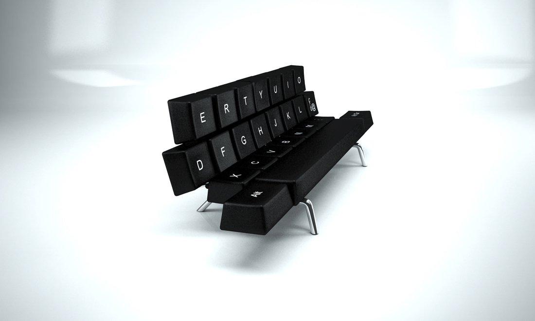 Диван-кровать черного цвета в форме клавиатуры