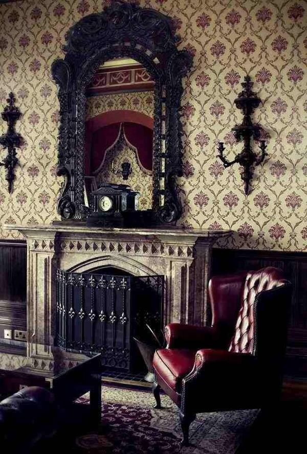 Готический стиль в интерьере гостиной с фальш-камином в квартире