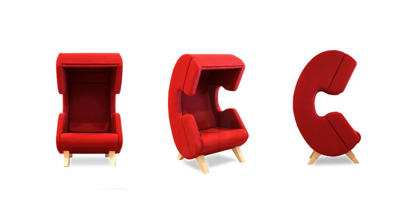 Дизайнерское мягкое кресло с тканевой обивкой